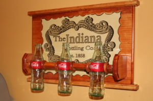 coke bottle coat rack c