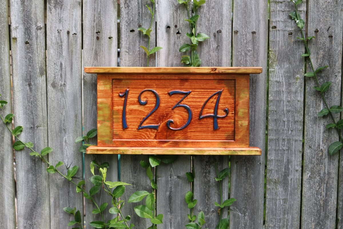 A mossy look street address number sign c