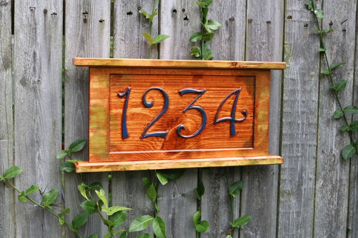 A mossy look street address number sign d
